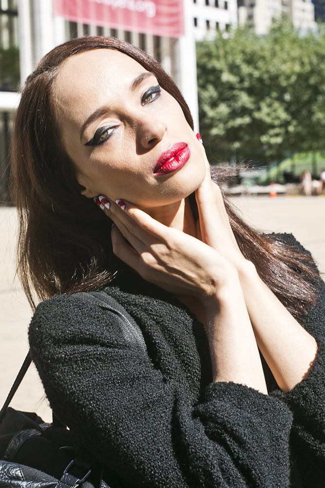 This woman's peppermint-stripe manicure was a sweet contrast to her sultry red lipstick.  Photo by Caroline Voagen Nelson
