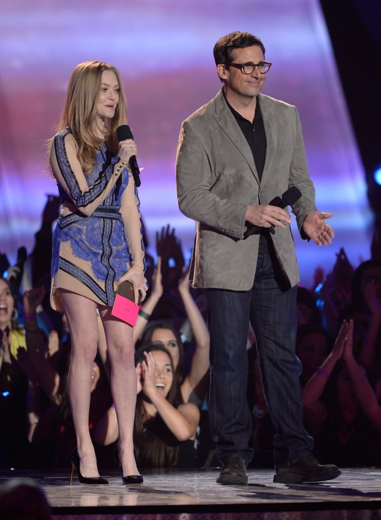Amanda Seyfriend looked chic in a blue-and-nude lace minidress and black patent Rupert Sanderson pumps on the MTV Movie Awards stage.