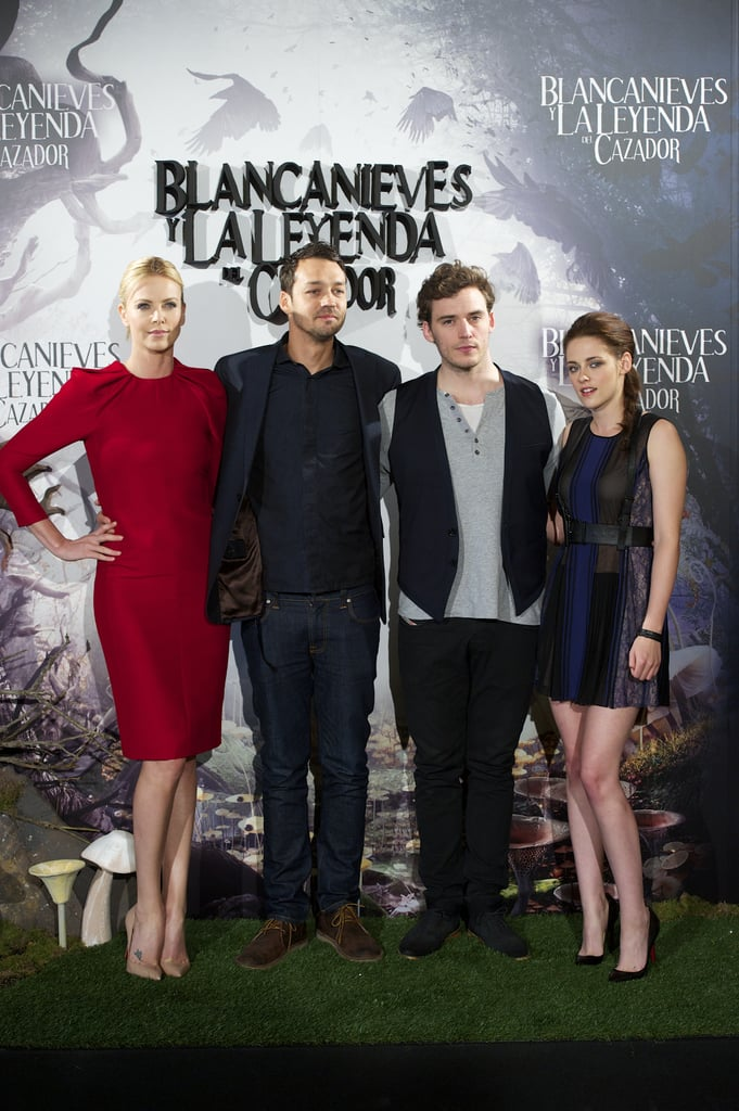 Charlize Theron, Rupert Sanders, Sam Claflin, and Kristen Stewart put on smiles for the Snow White and the Huntsman photocall in Madrid.
