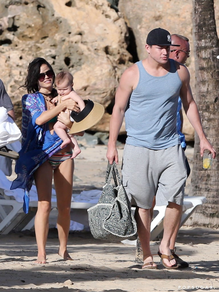 """It was a family day at the beach for Channing Tatum, Jenna Dewan, and their daughter, Everly, in Puerto Rico on Monday. The family of four lounged in the sun, where Jenna, who gave birth to Everly just six months ago, wore multiple bikinis. In these When Channing wasn't relaxing in a lounge chair, he took on dad duty, wearing Everly in a sling under the shade of palm trees. Channing and his girls got in some quality time on the beach during a break from Channing's busy work schedule, which has him in Puerto Rico for the sequel to 21 Jump Street. He's been filming  22 Jump Street with Jonah Hill in New Orleans for the last few months. Channing broke from the set to chat with Ellen DeGeneres about his daughter last month, though, gushing about her first tooth being """"the cutest thing."""" Everly's adorableness landed her a spot on our Best of 2013 most exciting celebrity baby arrivals poll — vote now!"""