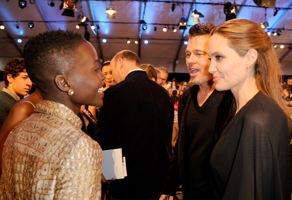 Lupita had a smiley chat with Brad and Angelina.