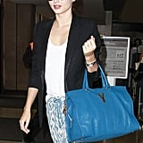 Miranda Kerr looked cute and casual as she caught a flight out of LAX.