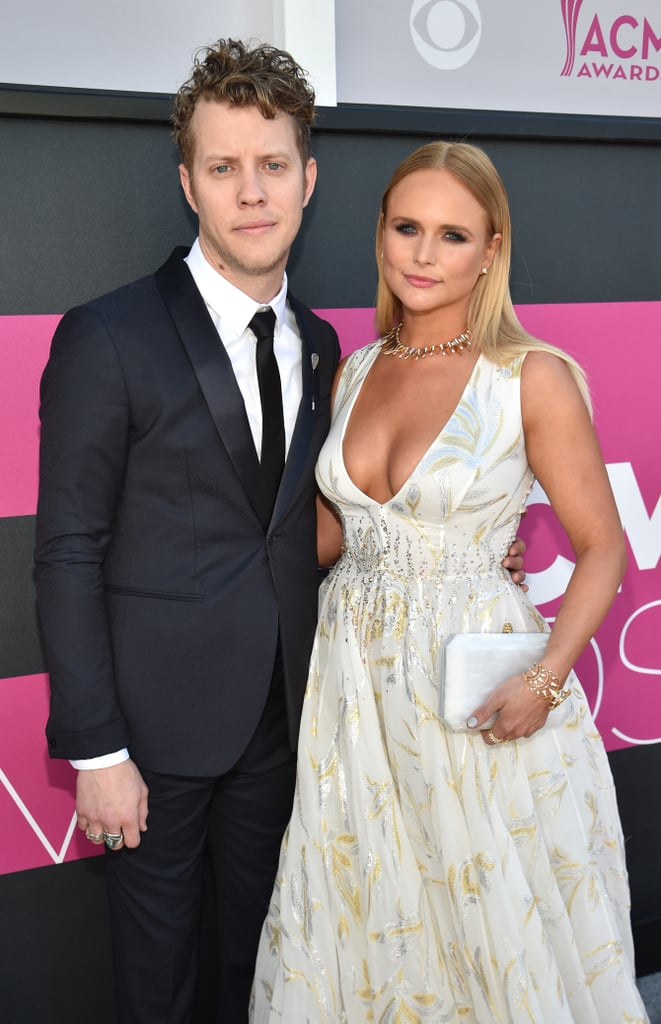 """Miranda Lambert and Anderson East had their own Cinderella and Prince Charming moment on Sunday night. The country couple hit the red carpet at the 52nd annual Academy of Country Music Awards, where Miranda stunned in a floor-length white gown streaked with silver and gold. Anderson — who has been dating the """"Vice"""" singer for a little over a year now — kept it classic in a suit. Judging from this lovely appearance, it looks like their relationship has been a total fairy tale.      Related:                                                                                                           Country Music's Hottest Couples Arrive in Style For the ACM Awards"""