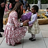 Awww! Kate knelt down to accept flowers from an adorable little girl during her visit to the the Immigrant Services Society of British Columbia during the royal tour of Canada in September 2016.