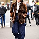 Tuck a tight-fitting turtleneck into the waist, and complete with a furry jacket.