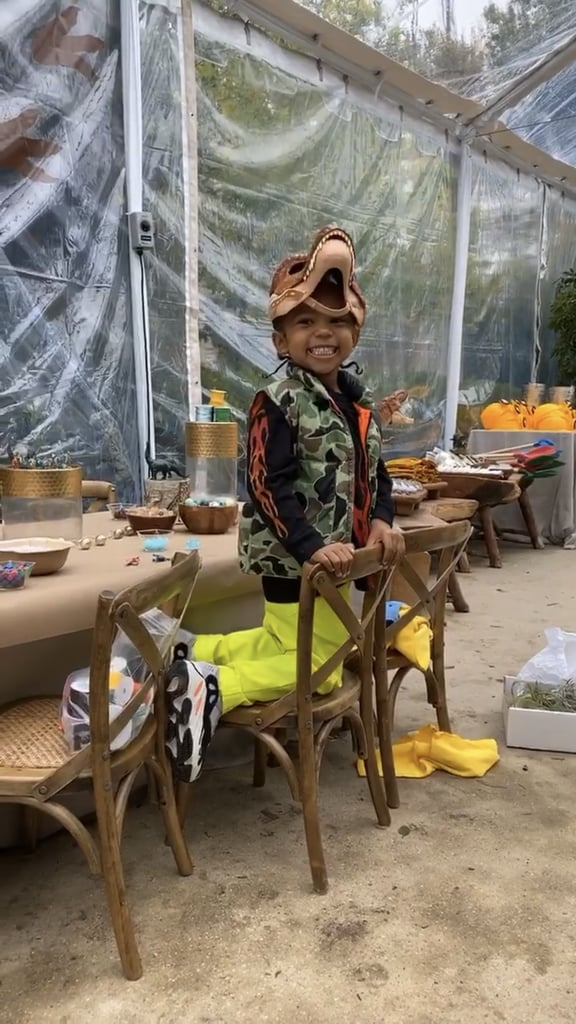"""Kim Kardashian went the extra mile to make her son, Saint, feel special for his birthday. On Saturday, the mogul threw her little one — who turned 4 on Dec. 5 — a dinosaur-themed party so elaborate, it could easily double as the set of Jurassic World 3. Kim took her Instagram followers on a tour of the outdoor gathering, sharing photos and videos of dinosaur-inspired sweets, play stations, and food trucks. """"Happy birthday, Sainty!!!"""" she captioned a clip. """"I love you."""" The get-together was a family affair, as Saint spent time with her siblings, 6-year-old North, 1-year-old Chicago, and 6-month-old Psalm. Khloé Kardashian and daughter True also took part in the festivities, joining other guests in a bouncy house. Attendees enjoyed a rainbow cake filled with M&M's before taking home their own children's Yeezy slides from Kanye West's shoe line. Check out more snaps from Saint's elaborate party ahead!      Related:                                                                                                           Warning: You're Not Ready For These 100+ Adorable Snaps of Kim and Kanye's Kids"""