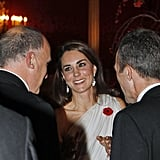 Kate Middleton wearing a red poppy.