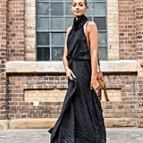 Give a black floor-length dress a daytime twist with tan accessories, just like so.
