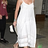 Amber Heard arrived at the airport in Japan wearing a white midi-length tank dress from Twelfth Street by Cynthia Vincent, nude sandals, and a studded Rebecca Minkoff bag.