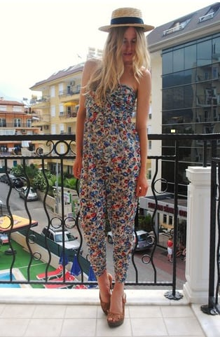 We adore a strapless jumpsuit with a sweet print for a new riff on vacation wear — just add a fedora and sandals like this for the same pretty effect. Photo courtesy of Lookbook.nu
