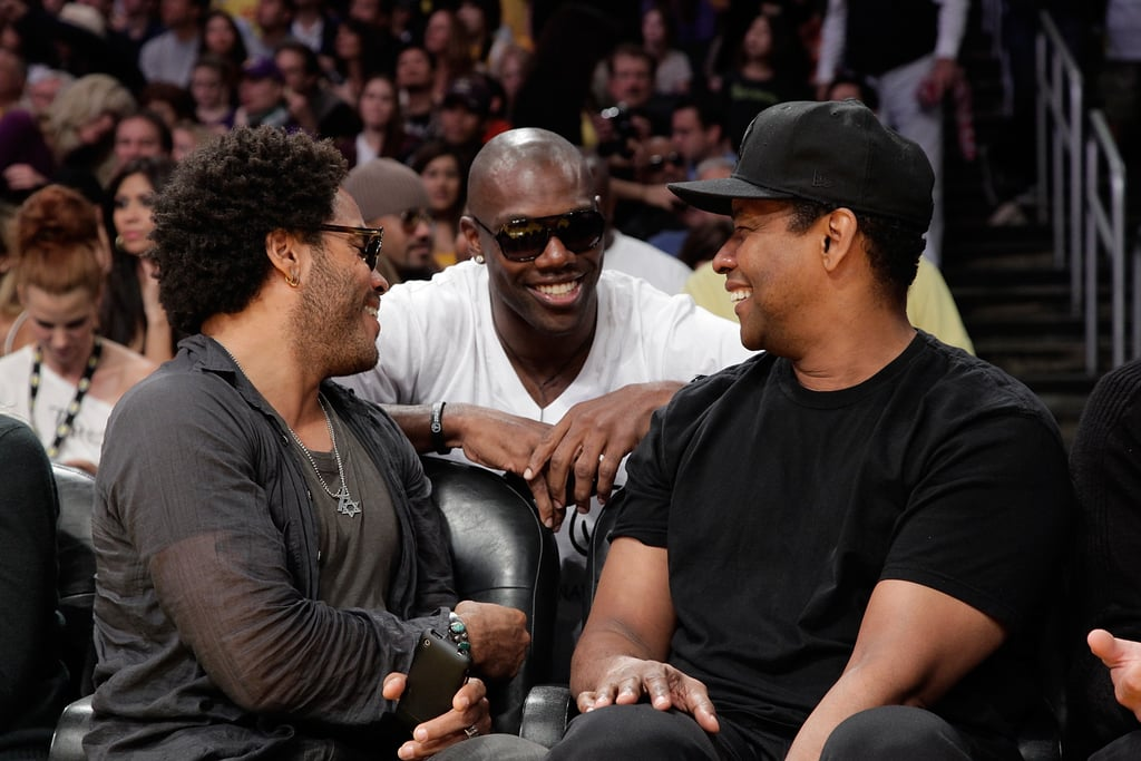 Lenny Kravitz and Denzel Washington chatted with Terrell Owens during a Lakers game in February 2010.