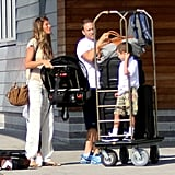 Gisele Bundchen carried a car seat.