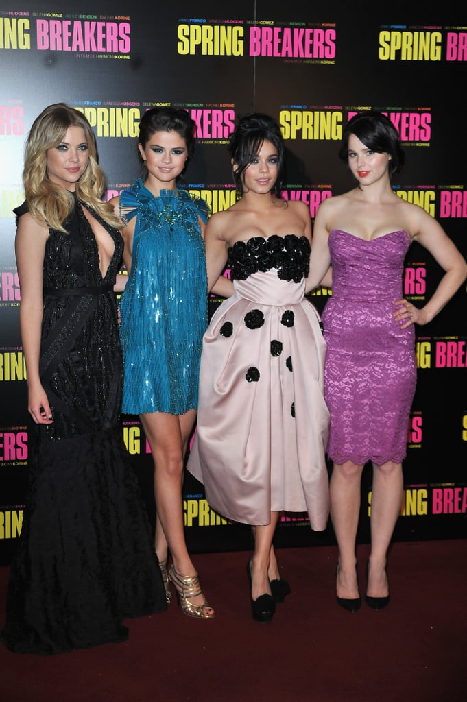 Selena Gomez posed in a bright blue Gucci minidress with her Spring Breakers costars Vanessa Hudgens, Ashley Benson, and Rachel Korine at the film's Paris premiere this evening. The girls touched down in France late last week and stayed busy by sightseeing and shopping around the city ahead of their big event. Selena also shared a photo of the group in front of the Eiffel Tower on her Twitter page. Vanessa Hudgens made the trip overseas after attending New York Fashion Week. We caught up with her during the festivities to talk about her favorite designers and swap style tips. Both Vanessa and Selena have garnered praise for their roles in the controversial movie, which hits theaters in the US on March 22.