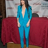 Back in 2014, She Sported a Coordinating Blue Pantsuit For a Book Signing