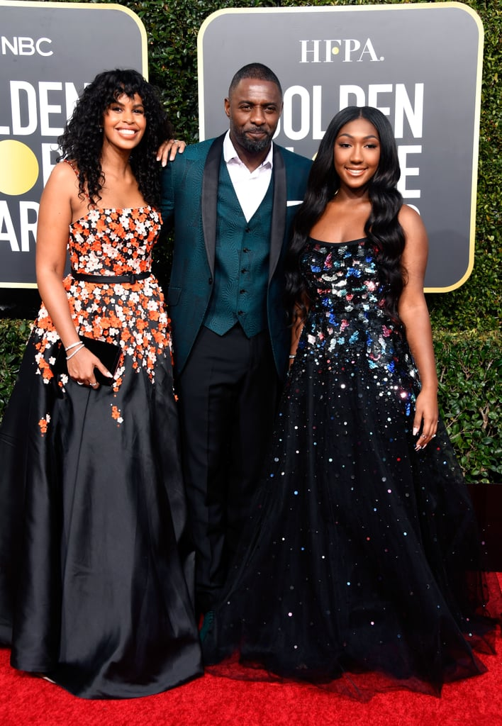 "If you thought money was the only reason to love the colour green, Idris Elba is here to enlighten you. The 46-year-old actor — and DJ, if you still haven't learned that tidbit — blessed the 76th Annual Golden Globes red carpet alongside his fiancée, Sabrina Dhowre, and his daughter, Isan Elba. Sporting a patterned green suit jacket with matching waistcoat and his usual roguishly-charming smile, the Sexiest Man Alive looked like he was living his best life on the red carpet. Isan, who serves as this year's Golden Globes Ambassador, continues to prove that her father doesn't have all the good looks in the family and, to top it all off, Sabrina has us dreaming of fields and fairies in the best possible way.  Before they walked the carpet, Idris revealed that he had been giving his daughter advice for her Ambassador duties, including the evergreen tip that ""elegance is presence."" Clearly Isan has taken note. Check out the gorgeous trio working the Golden Globes red carpet ahead!"
