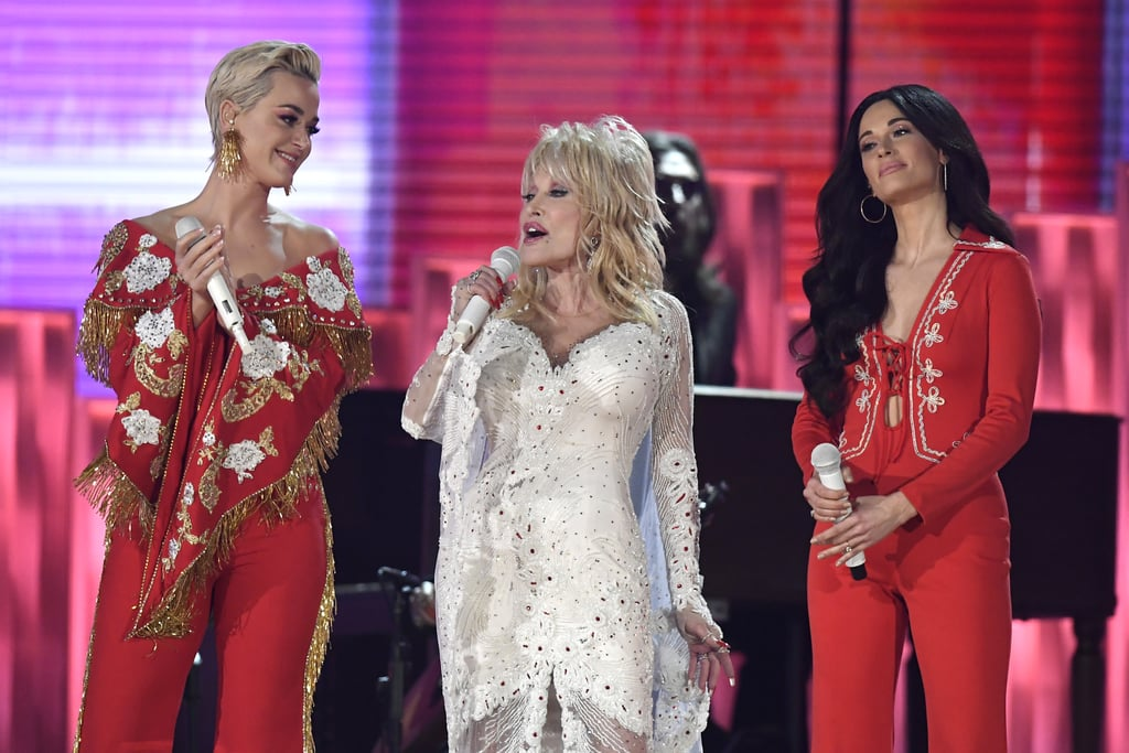 "Some of the biggest names in music shared the stage as they paid tribute to Dolly Parton at the Grammys. On Sunday, Kacey Musgraves, Katy Perry, Maren Morris, Little Big Town, and Dolly's goddaughter Miley Cyrus came together to sing an epic medley of songs like ""Jolene"" and ""Here I Go Again."" As if that wasn't exciting enough, Parton sang alongside them on stage, marking her first Grammys performance since 2001. The show was certainly a big night for the 73-year-old country music singer. In addition to the tribute, Parton was also recognized as the 2019 MusiCares Person of the Year. Nothing but the best for a legend like Dolly Parton!       Related:                                                                                                           Dolly Parton Brought the Dancing Emoji to Life For Her Huge Night at the Grammys"