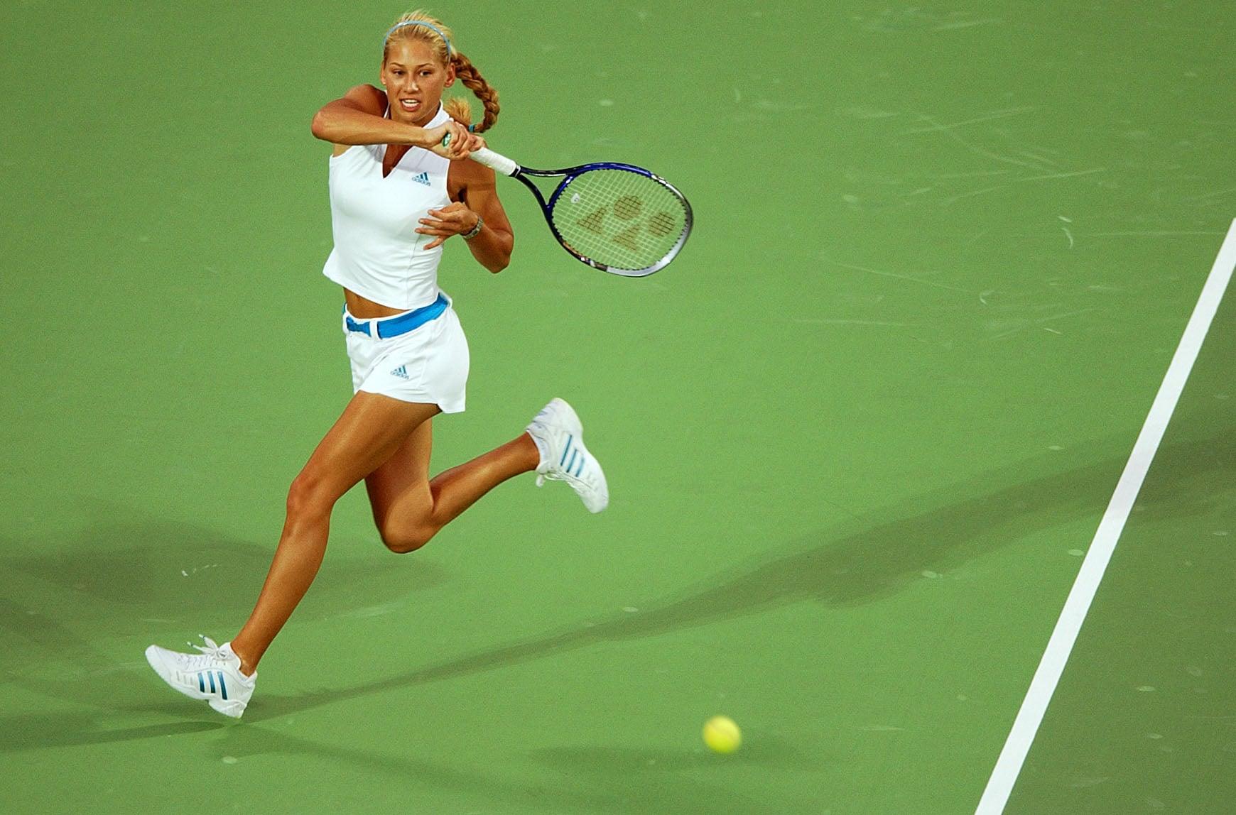 Anna Kournikova displayed her favourite designer brand and colours in an all Adidas tennis attire.