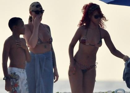 Rihanna Enjoying a day of beachgoing bliss in her native Barbados on Monday afternoon (December 27)with family and friends