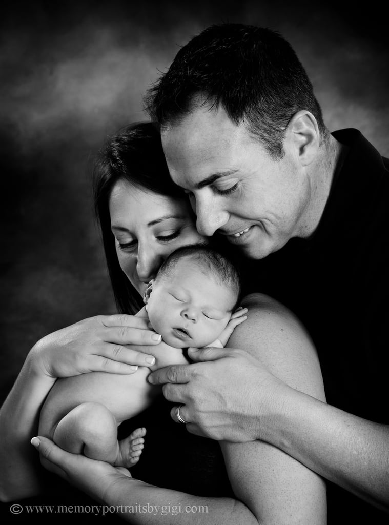 Baby poops on dad during newborn photo shoot