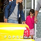 Katie Holmes held Suri Cruise's hand as they arrived at JFK Airport.