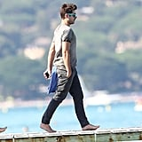 Zac Efron went barefoot in the French Riviera.