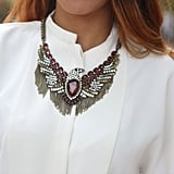 Bold jewels upgraded a basic blouse.