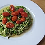 A big bowl of spiralized zucchini is the perfect bed for juicy, blistered cherry tomatoes this Summer.