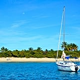 A sailboat floating in Caribbean waters.