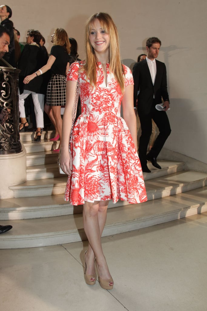 Jennifer Lawrence looked lovely on arrival in a fit-and-flare printed dress at Dior.