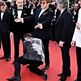 Next, Elton Takes a Moment to Show Off Taron's Shoe-Tying Skills