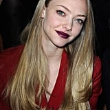 Amanda Seyfried wore dark lips to attend the Miu Miu show during Paris Fashion Week.