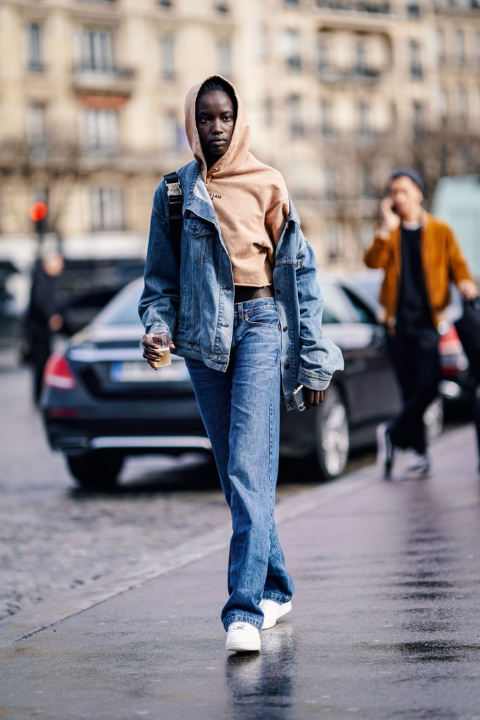 Put an athleisure spin on double denim by styling in a hoodie and sneakers.