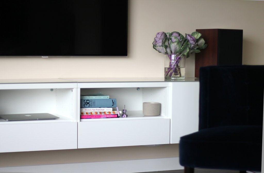 Thanks to the Swedish superstore savior, you can DIY your own media center with the Besta unit. The floating element and slick white-gloss finish help it sink into the wall, giving the impression of more space. Check out how to make this media console yours for only $230 here!