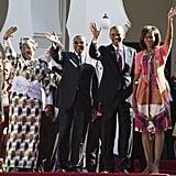 In Tanzania, the Obamas waved alongside Tanzanian President Jakaya Kikwete and First Lady Mama Salma Kikwete in July 2013.