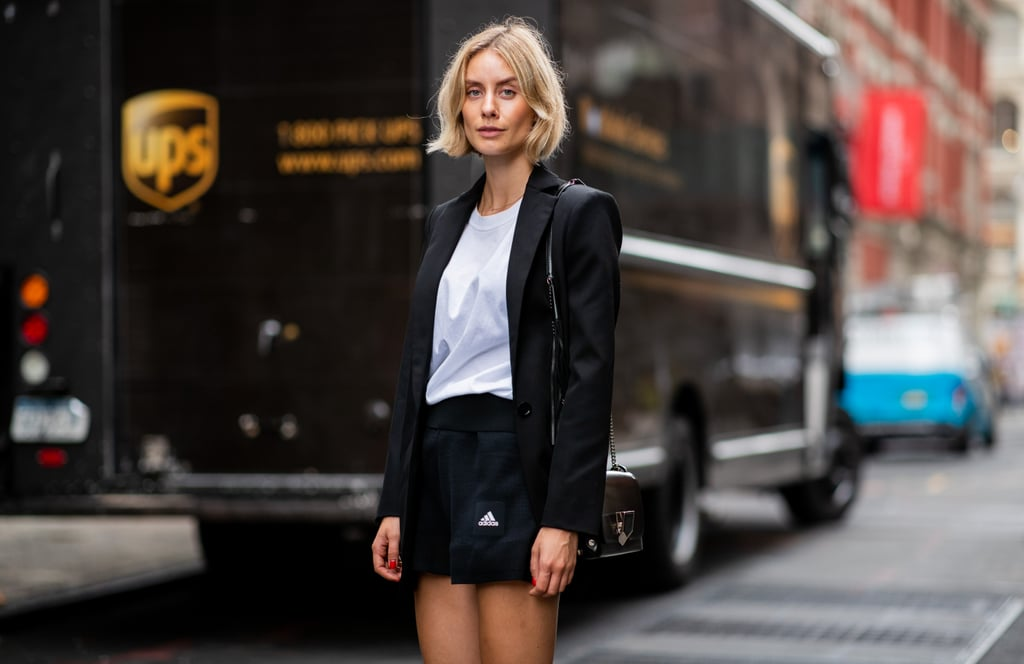 A tailored blazer and sporty shorts feel harmonious, thanks to a tee.
