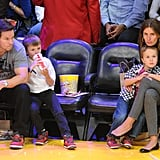 Mark Wahlberg and Rhea Durham cuddled up with their two sons at the game in LA.