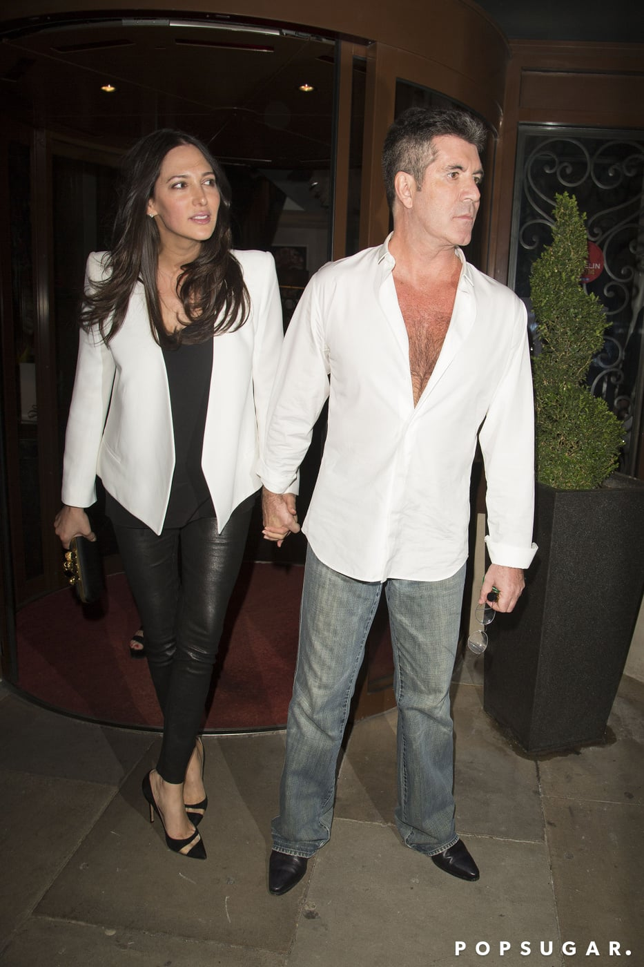 Lauren Silverman and Simon Cowell attended a birthday party in London on Sunday.