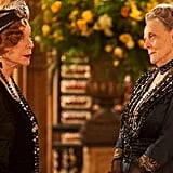 The addition of Cora's mother, Martha Levinson, to the cast in season three created a clash of sorts. The Dowager Countess of Grantham represents the classic Edwardian age (think: Gibson Girls), while the visiting matriarch embraces a more nontraditional persona (think: Louise Brooks). As you can see, Martha (left) doesn't shy away from loads of accessories and a bit of lip rouge. Source: ITV