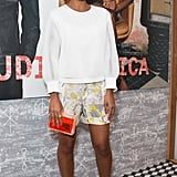 Solange's abstract-print Edun shorts popped against her white Theyskens' Theory blouse, while gold metallic sandals and a neon, lucite CC Skye clutch added just the right amount of flair.