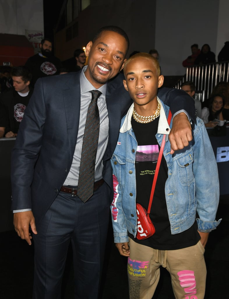 "It's safe to say Will and Jaden Smith had more fun than anyone else at the world premiere of Netflix's Bright in LA on Wednesday night. The 49-year-old and proud father brought along his 19-year-old mini me, who performed on the red carpet and also posed for selfies with his famous dad. Will looked sharp in a navy blue suit and made sure to grab photos with costars Lucy Fry and Joel Edgerton, as well as Girls Trip actress Tiffany Haddish. Jaden opted for a more casual look, sporting a denim jacket, sweats, and gold chains around his neck. In April, Will helped Jaden prepare for a movie role by chopping off his blond dreadlocks. ""Maybe I should've used scissors?!"" he joked, sharing photos of Jaden's new look. See more of their fun night out now below, then check out the Smith family's most memorable moments on the red carpet."