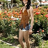 Adopt a little cowgirl attitude with a flash of denim, some leather fringes and a super cool floppy hat!