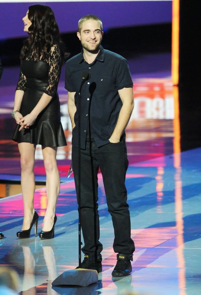 Robert Pattinson won big at this evening's People's Choice Awards in LA! He picked up the best drama honor on behalf of his movie Water For Elephants. His costar Reese Witherspoon didn't turn out for the event, but Rob had another leading lady in the seat beside him — Rob was placed next to Hot in Cleveland's Betty White! Ashley Greene, who is one of the Twilight gang with Rob, was there to hand off the award. Robert Pattinson shaved his head for tonight's show too. It's a new year, and a new look for Twilight heartthrob Rob. This year is starting with a win, and more highlights are to come. He has Bel Ami due out in the coming months, in addition to his David Cronenberg picture Cosmopolis and, of course, Breaking Dawn Part 2 out this Fall.