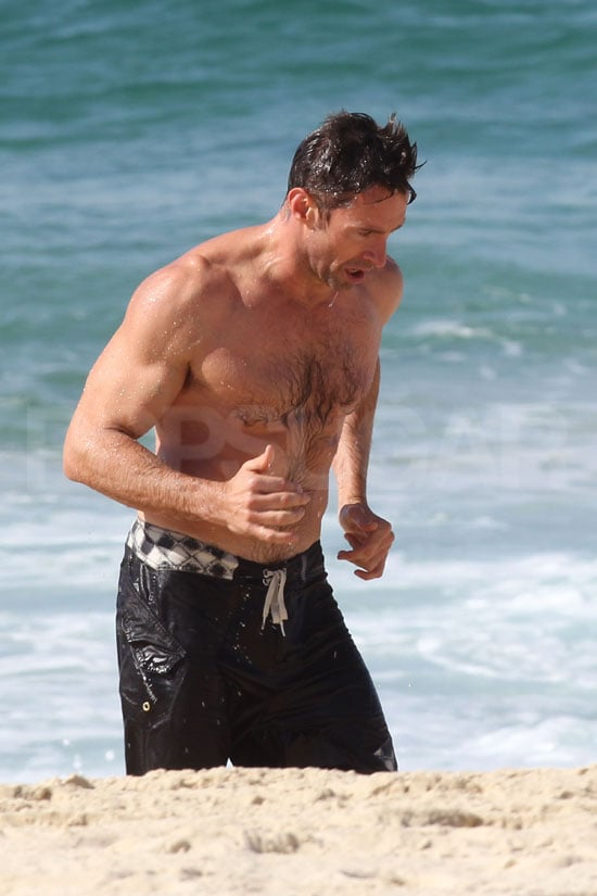 Hugh Jackman went for a shirtless run on the sand.