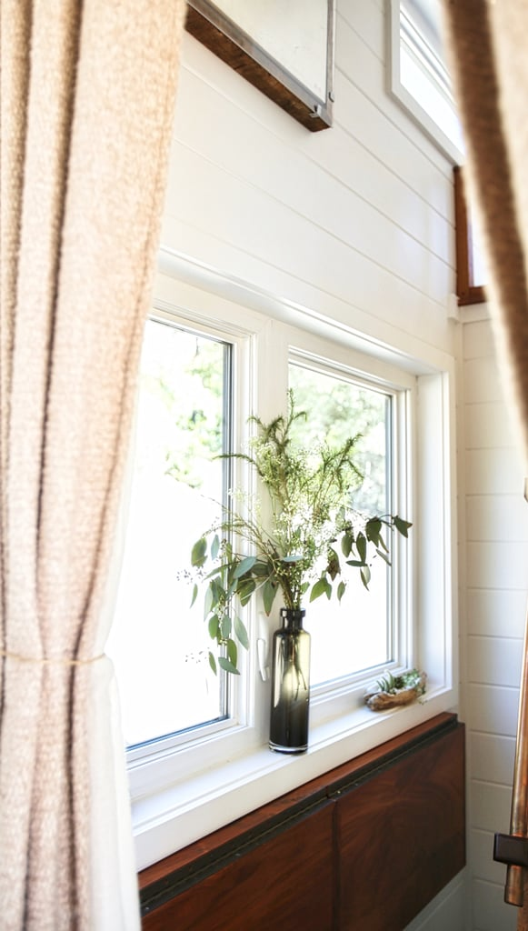 To keep the space bright and lively, Bela brings a little bit of nature inside by adding vases of fresh greenery to her windowsills.