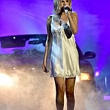 Selena took the stage in a white slip dress by Ginia at the 2017 American Music Awards.