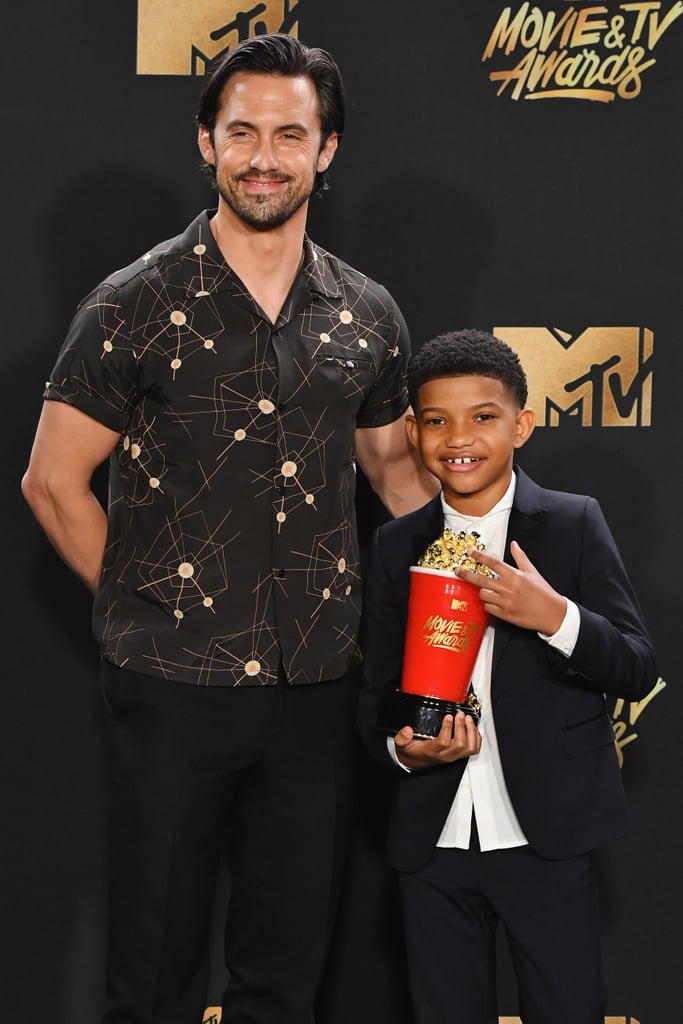 This Is Us may be on a hiatus, but the cast's bond is as strong as ever. On Sunday, a few of the stars reunited for the MTV Movie and TV Awards. The Pearson family patriarch, Milo Ventimiglia (Jack), posed for a few photos on the red carpet, while his onscreen son Lonnie Chavis (who plays young Randall) made our hearts melt with his warm smile. Chrissy Metz (Kate) even participated in host Adam DeVine's Beauty and the Beast-themed opening number. Not to mention Milo and Lonnie's cute moment on stage when they took home the best tearjerker moment. Gosh, we love this cast.