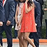 Wearing a tangerine Alice + Olivia dress in Cuba.