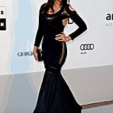 Julia Restoin-Roitfeld looks dynamite in her black cutout dress.