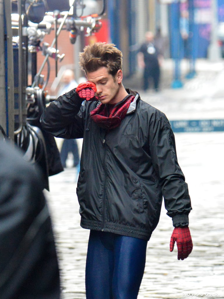 Andrew Garfield wiped his eye during a long day on set in NYC.