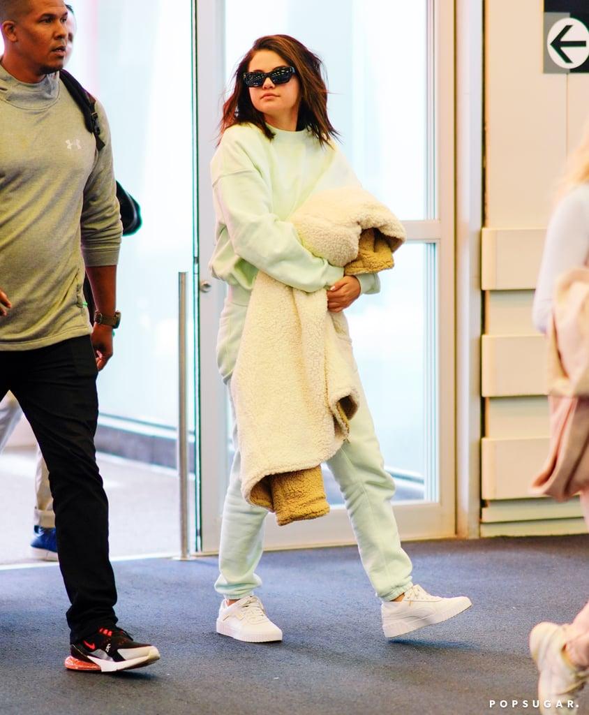 Selena Gomez Green Sweatsuit At Airport 2019 Popsugar Fashion